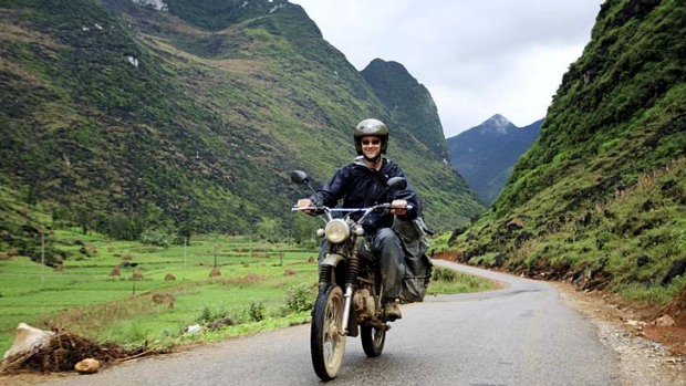 Roads to happiness ... one of the group's motorcyclists in the mountainous Ha Giang province.