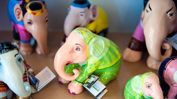 Colour Factory sells brightly painted elephant figurines.