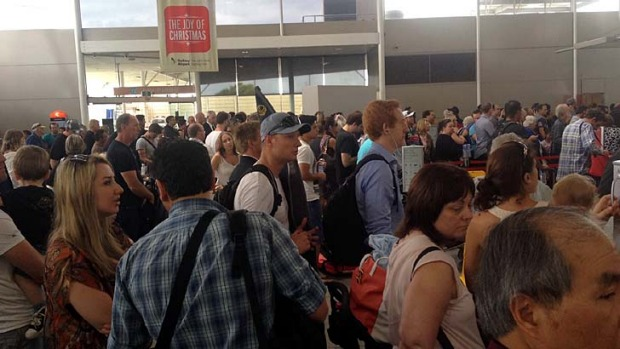 Delays ... Overcrowding at Sydney Airport renders announcements inaudible.