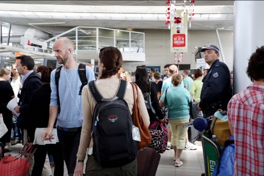 Passengers queue as delays hit Sydney Airport.