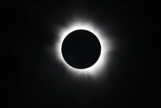 Total solar eclipse at Palm Cove in Cairns, Australia.