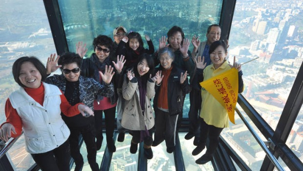 Southern star ... Chinese tourists on the Eureka Skydeck in Melbourne.
