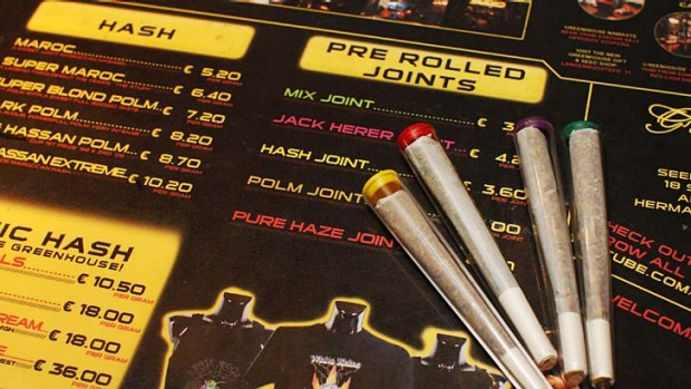 Pre-rolled joints are seen on an english language menu listing the variety of hash and marijuana on sale at a coffee ...