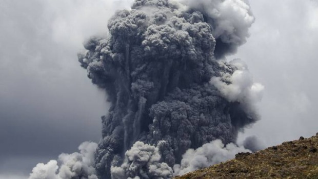 A massive plume of ash billows up into the sky as Mount Tongariro erupts at Tongariro National Park.