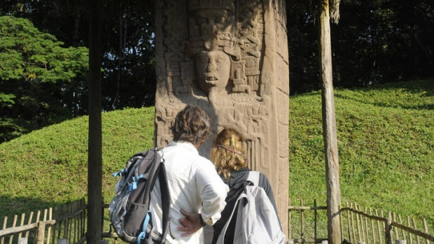Tourists look at a Mayan stela at the Quirigua archaeological site. Ceremonies will be held here to celebrate the end of ...