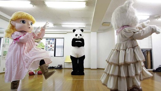 Watch and learn ... trainees in character mascots costumes practice their movements at the Choko Group mascot school in ...