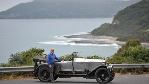 Peter Latreille with his vintage car on the Great Ocean Road.