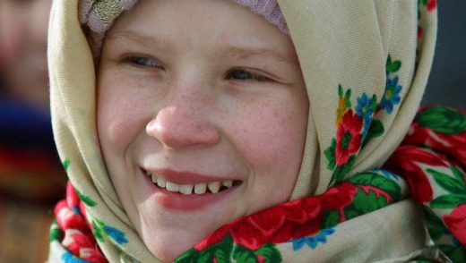 A young girl in traditional clothing.