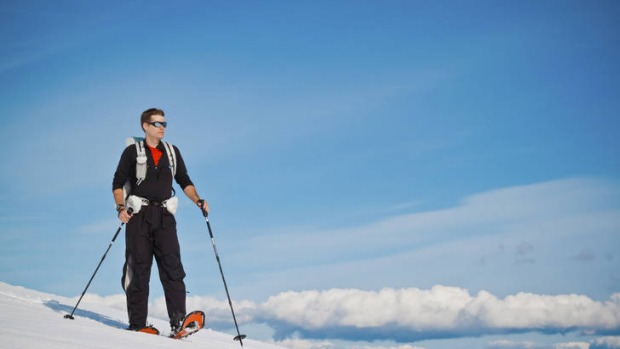 Soft shoe shuffle...snowshoes point the way to majestic solitude on Grouse Mountain, a playground for Vancouver's skiiers.