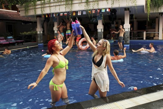 (L) Bailey Sciberras 18 and (R)  Erin Barnett 17, enjoy cold drinks poolside at the Bounty Hotel, Kuta.