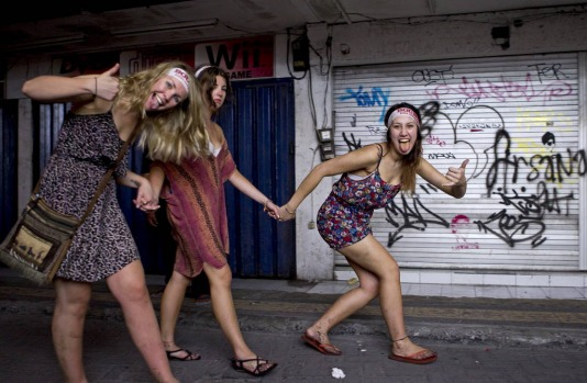 Schoolies heading home through the back streets of Kuta after a big night of partying.