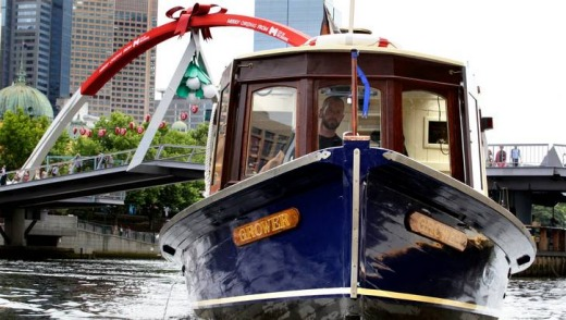 Hamish Turner at the wheel of refurbished riverboat Grower will run a city loop water-taxi service from Friday.
