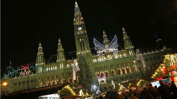"People gather at a Christmas market, in front of the ""Rathaus"" townhall of in Vienna. The tourist mecca has been named ..."