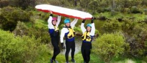 Yah, we conquered the Thredbo River on a river sled (that's your columnist, sans akubra, in the centre...)!