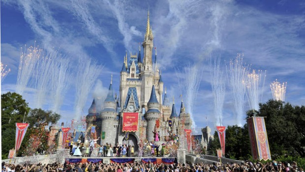 Fireworks light the sky over Cinderella Castle during the Grand Opening of New Fantasyland at Walt Disney World Resort.
