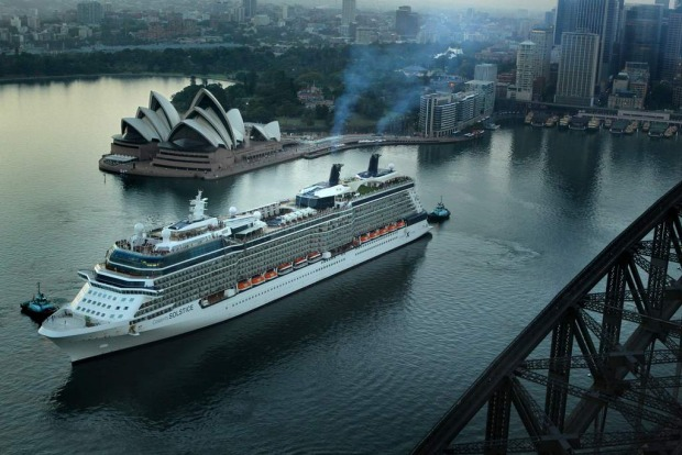 The Celebrity Solstice passes the Sydney Harbour Bridge as it docks at Circular Quay.