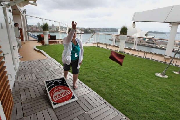 Dallas Bent, up on the deck, enjoys one of the many activities on board the Celebrity Solstice.