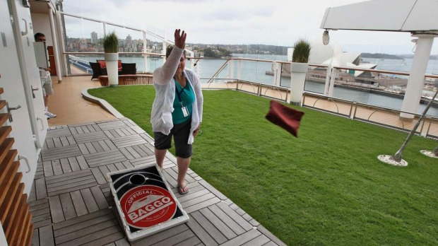 Dallas Bent, up on the deck, enjoys one of the many activities on board the Celebrity Solstice. December 11, 2012.
