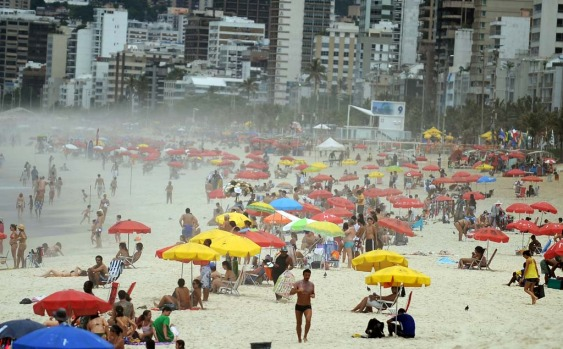 People enjoy at Ipanema beach in Rio de Janeiro as summer arrives.