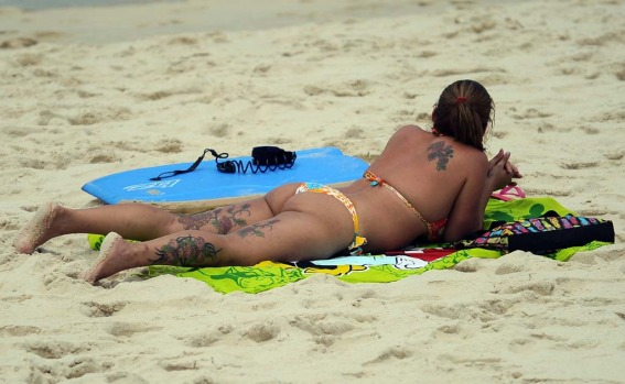 A woman sunbathes at Ipanema beach in Rio de Janeirro.