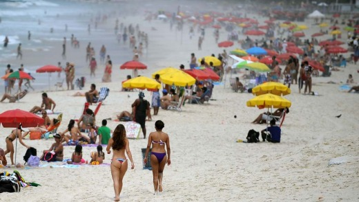 People at Ipanema beach in Rio de Janeiro as the temperatures soar to mark the beginning of summer.