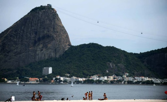 People enjoy Flamengo beach in front of the Sugar Loaf hill in Rio de Janeiro.
