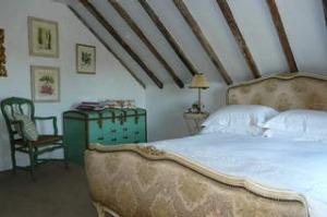 Simply French...exposed timber beams in the bedroom.