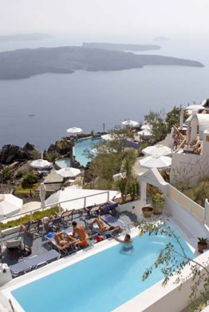 Relaxing by the pool in Thira, Santorini.
