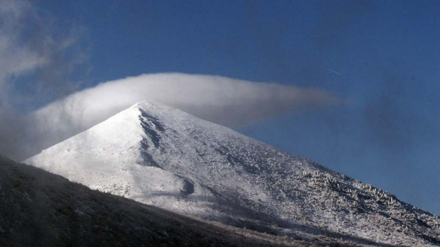 The pyramid-shaped Siljak peak in the Serbian mountain of Rtanj on December 20, 2012. Visitors were flocking to the pyramid-shaped mountain in southeastern Serbia, ahead of the Mayan-foretold 'doomsday', local officials said Thursday. Hotel beds near Rtanj mountain, had been booked up well in advance, local tourist officials said.