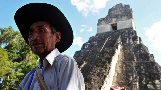 A Guatemalan Maya native visits Tikal archaeological site in Peten departament 560 km north of Guatemala city on December 20, 2012. Ceremonies will be held here to celebrate the end of the Mayan cycle known as Bak'tun 13 and the start of the new Maya Era on December 21.