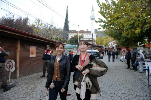 Tourists and inhabitants walk through the streets of Sirince, a village in western Turkey on December 20, 2012. ...