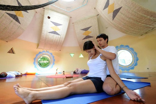 Romanian therapist Pasca Silviu-Vasile applies a massage  to a woman during therapy session in Alto Paraiso town, Goias ...