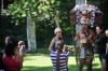 Tourists take pictures with a man dressed in a Mayan costume in the Tikal archaeological site in Peten departament 560 ...