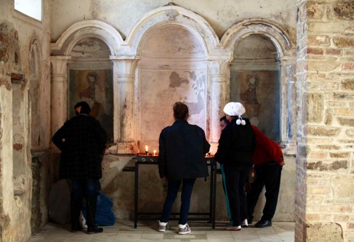People light candles at the ruins of St. John church in Sirince December 20, 2012. Thousands of foreign and local ...
