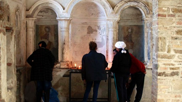 People light candles at the ruins of St. John church in Sirince December 20, 2012. Thousands of foreign and local tourists are expected to flock to Sirince, a small Turkish village near the ancient Greek city Ephesus ruins, which is believed to be one of the few places on earth that will survive the Mayan calendar doomsday this Friday.