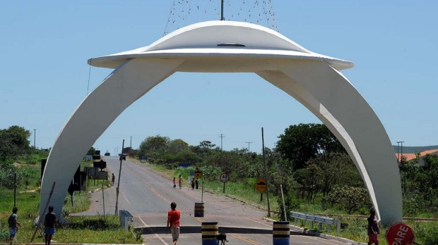 Children play next to a UFO-shaped gate in Alto Paraiso town, Goias State, 230 kms north of Brasilia, on December 20, 2012. Situated over a huge quartz crystal plate, Alto Paraiso attracted many Brazilians and foreigners seeking refuge from the events expected by the Mayan prophecy that predicts the end of the world or the beginning of a new era.