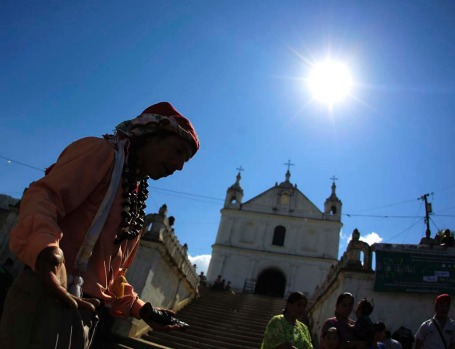 "Carlos Tun, a Mayan priest, prays and participates in the pre-Hispanic mass of ""Primera Conexion"" and ""Sincronizacion ..."