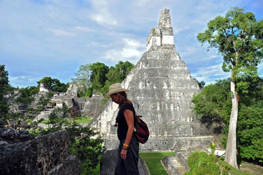 A tourist is seen in near a Mayan temple at the Tikal archaeological site in Peten departament, 560 kms north of ...