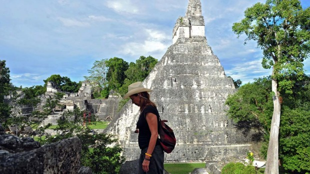 A tourist is seen in near a Mayan temple at the Tikal archaeological site in Peten departament, 560 kms north of Guatemala City, on December 19, 2012. Ceremonies will be held here to celebrate the end of the Mayan cycle known as Bak'tun 13 and the start of the new Maya Era on December 21.