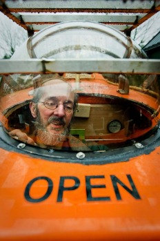 Duch Pieter van der Meer poses on December 19, 2012 in his Norwegian lifeboat in his garden in Kootwijkerbroek with ...