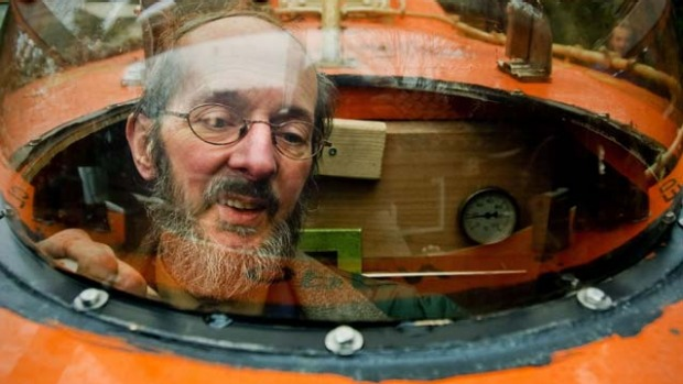 Duch Pieter van der Meer poses on December 19, 2012 in his Norwegian lifeboat in his garden in Kootwijkerbroek with which he can save 35 persons in case of a global apocalypse hits on 21 December.
