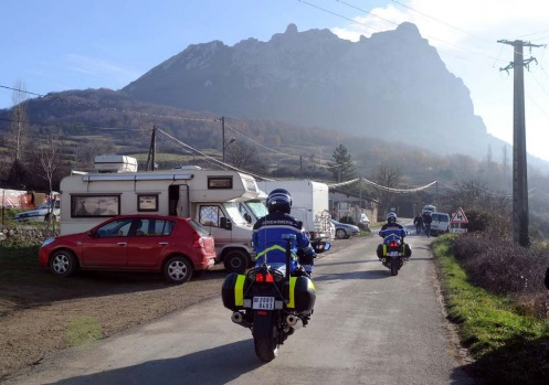 French Gendarmes patrol in a street o where mobil-homes parked, on December 20, 2012, in the French southwestern village ...