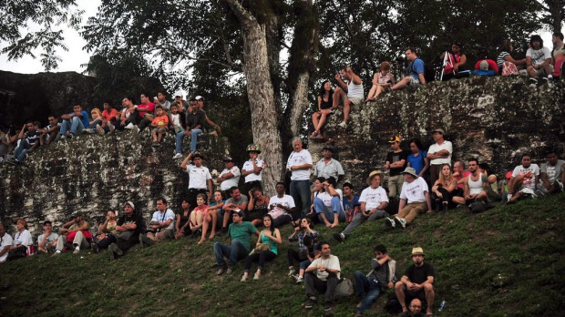 Tourists wait for celebrations to start for the end of a 5200-year era in the Mayan Calendar in the Tikal archaeological site in Peten departament 560 km north of Guatemala city.
