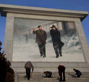 Children sweep the steps of a monument to North Korean leaders Kim Il-Sung and Kim Jong-Il.