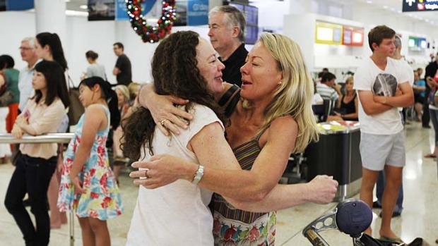 Presence wrapped with arms of love and joy … Margie Rawlinson welcomes her sister Janet Oag, who travelled from ...