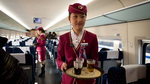 Toilets on the world's longest bullet train service (China) are of stainless steel squat variety, with slightly more bathroom space than would usually be found on an airliner, while uniformed women were on hand to serve drinks and snacks during the trip.