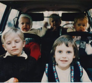 A rear-facing Simon Castles, second from left, and siblings in the Volvo.