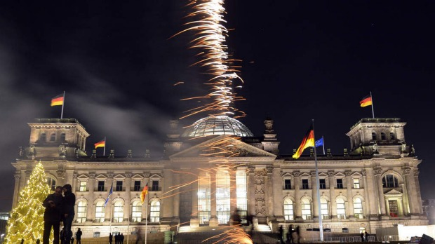 Fireworks erupt in front of the Reichstag in Berlin.