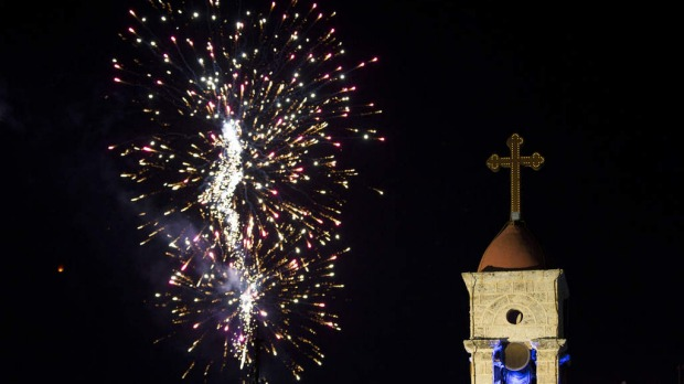 Fireworks explode over Mary's well, or The spring of the Virgin Mary during the New Year's celebrations in Nazareth.