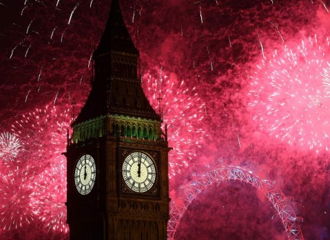 Fireworks light up the London skyline and Big Ben just after midnight.